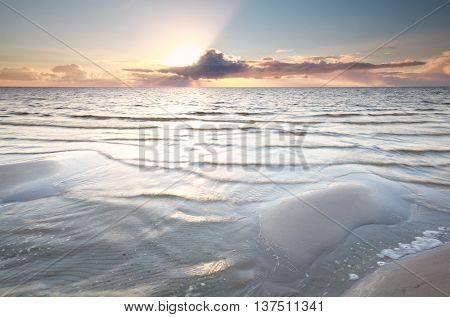 sunset on Ijsselmeer lake coast Friesland Netherlands