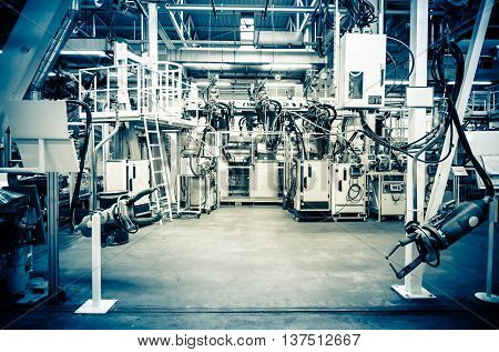 Modern assembly line without workers. In blue.