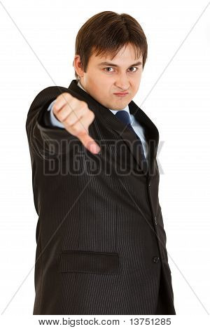 Attentive modern businessman holding hand at forehead and looking away isolated on white