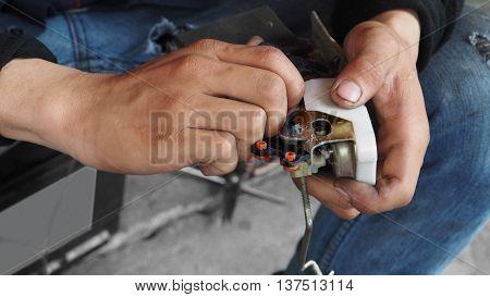 Repairman electric current Car lock in his hand