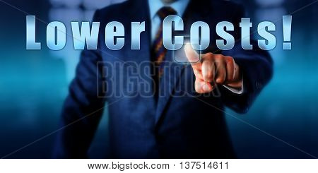 Business manager is touching Lower Costs! on an interactive control monitor. Call to action business objective concept and controlling metaphor. Close up shot of male torso in business suit.