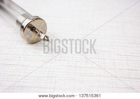 Vintage syringe on white table, medical equipment