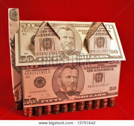 A house made of fifty dollar bills with a penny foundation