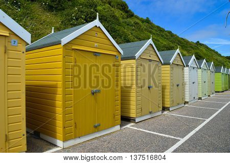 England, Bournemouth, July/2016. This picture has been taken in south England during summer time. It shows the cabins rented for customers during the summer. All cabins have a different colors. Guests can keep their stuff for summer inside their tents.