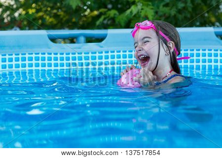 Excited Happy Little Girl In Swimming Pool