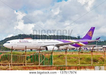 PHUKET , THAILAND- OCTOBER 25, 2014: Thai Airways plane waiting flight in Phuket International Airport. Thai Airways - national airline was founded in 1960 and is one of creators of the Star Alliance
