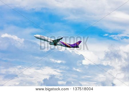 PHUKET , THAILAND- OCTOBER 25, 2014: Thai Airways plane takes off from Phuket International Airport. Thai Airways - national airline was founded in 1960 and is one of the creators of the Star Alliance