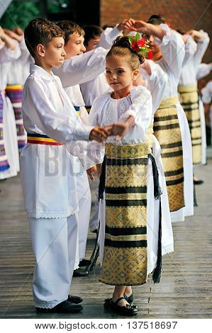ROMANIA TIMISOARA - JULY 6 2016: Child Romanian dancers in traditional costume perform folk dance during