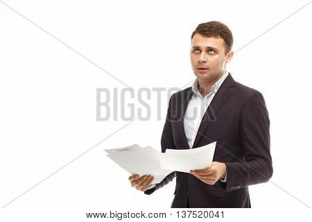 Handsome businessman in suit with papers isolated on white roll one's eyes