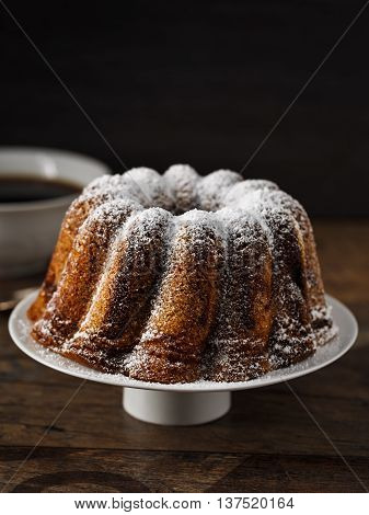 homemade bundt cake with icing sugar on top