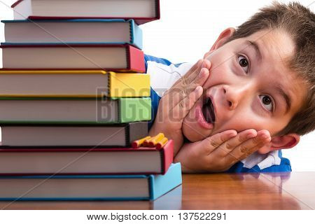 Shocked Young Boy Looking At His Textbooks