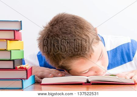 Overworked Young Schoolboy Fallen Asleep