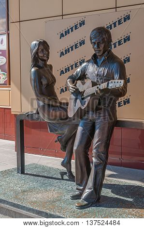 YEKATERINBURG RUSSIA - AUGUST 23 2013. Musical monument to the great Russian poet singer and actor Vladimir Vysotsky and French actress Marina Vlady in Yekaterinburg closeup view