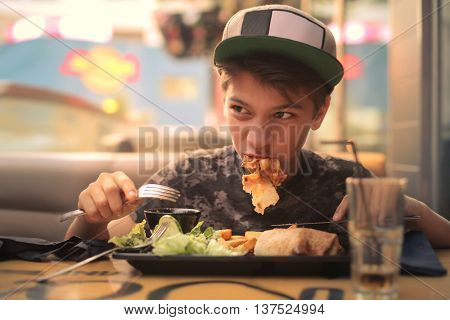 Kid eating at a fast food restaurant