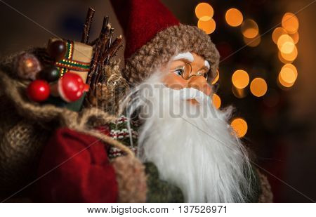 Santa Claus doll with a bag of gifts symbolizes the arrival of Christmas and New Year
