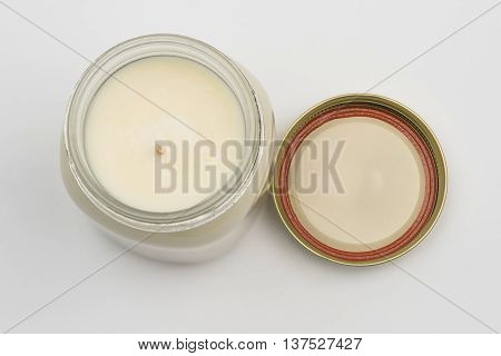 Looking down at a jar candle with lid