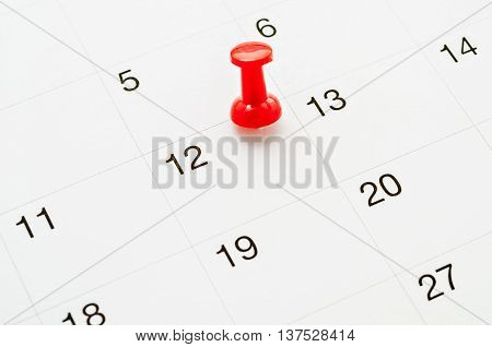The Red Thumb Tack on Calendar Page