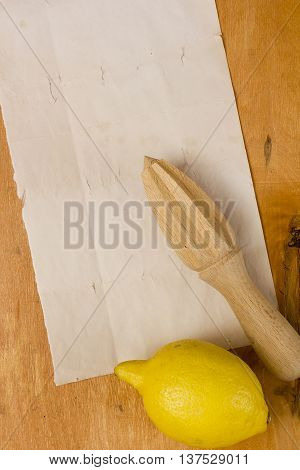lemon and squeezer on a wooden background