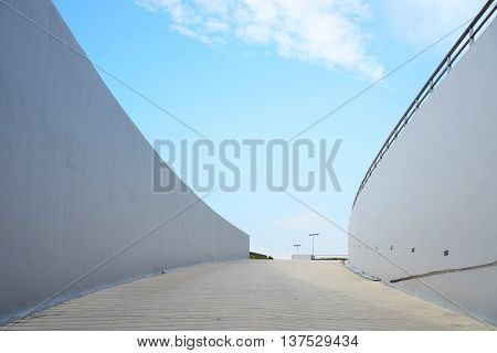 Pathway direction against blue sky in daytime