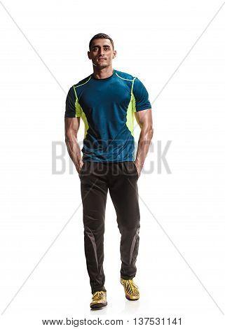 Handsome muscular man walking on white background