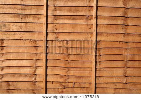 Orange Wood Stained Fence Background.