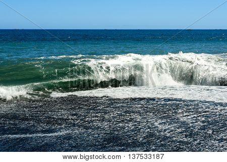 Waves In The Sea. Black Sand Volcanic Beach
