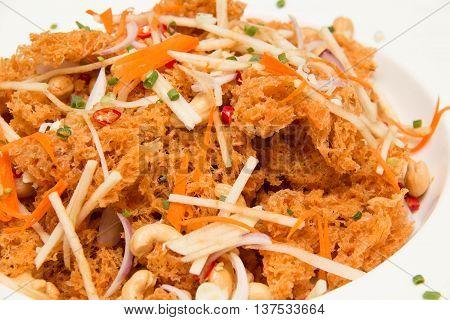 Crispy catfish spicy salad with mango Thai food style
