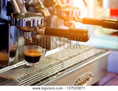 prepares espresso from machine  in coffee shop