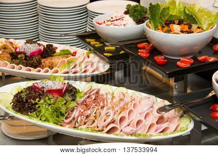 A dish of mixed cold cuts food for background
