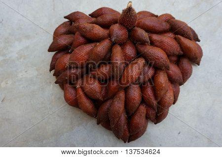 set up Salacca zalacca fruits in heart shape