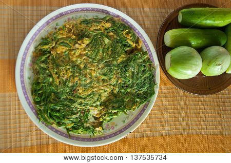Fried Acacia Pennata with beaten egg (cha-om kai in Thai)