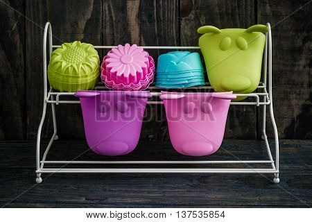 Stack Of Colorful Silicon Cake Molds