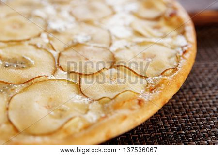 Pizza with pear and gorgonzola cheese, close-up