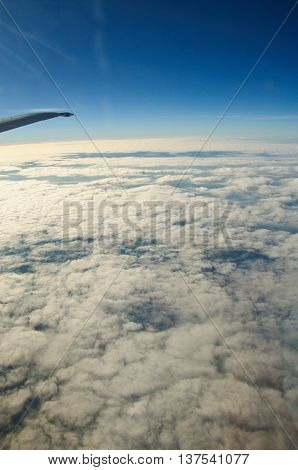 cloud scape of window at flying airplane