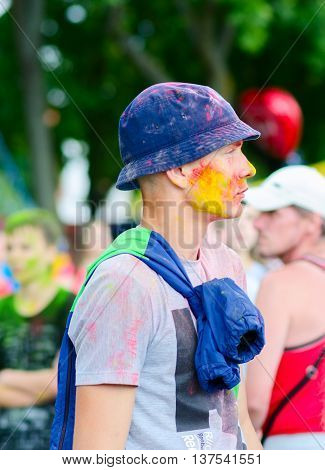 GOMEL BELARUS - JULY 6 2016: Unknown young man at festival of colors (Holi Festival or ColorFest) in Gomel Belarus
