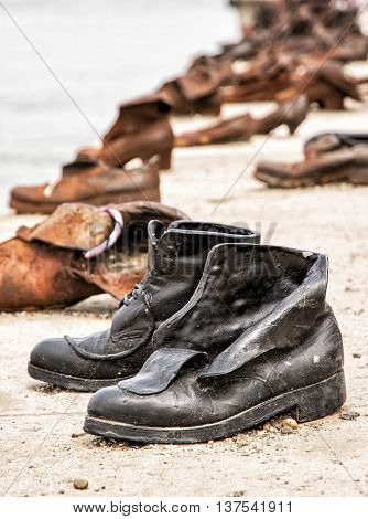 Shoes monument on the Danube bank is a memorial in Budapest Hungary. Place of reverence. Cultural heritage. Symbolic object. Vertical composition.