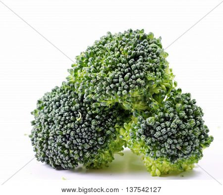 A close up of three Broccoli florets isolated on white background