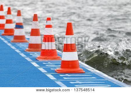 STOCKHOLM - JUL 02 2016: Orange cones on the swimming start in the Women's ITU World Triathlon series event July 02 2016 in Stockholm Sweden