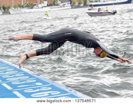 STOCKHOLM - JUL 02 2016: Female swimmer jumping into the water in the Women's ITU World Triathlon series event July 02 2016 in Stockholm Sweden