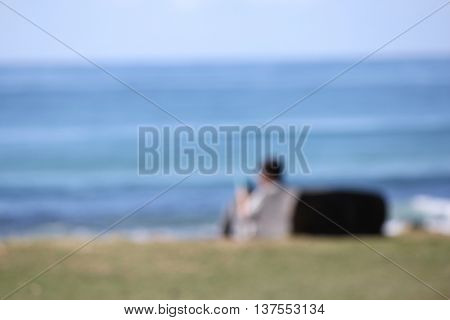 Soft Focus Single Person looking at the Ocean