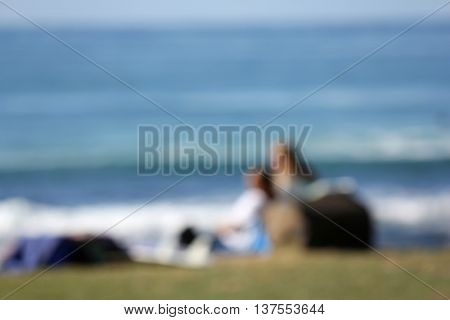 Soft Focus Couple looking at the Ocean