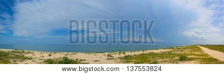 beach panorama. Long and empty sea coast beach panoramic view background
