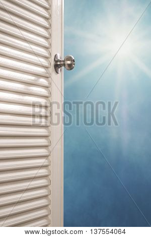 Door opening with blue sky and shiny sunshine, dreamy concepts