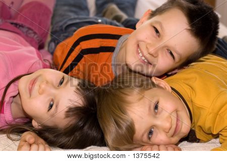Three Smiling Kids Having Fun