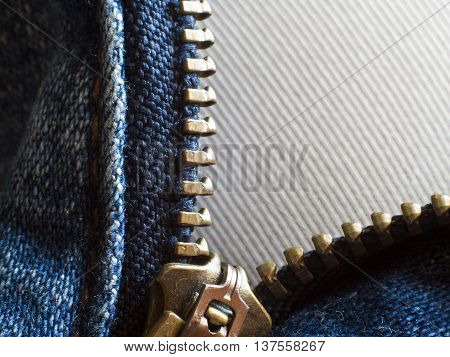 Close up to texture and zip of Denim Jean