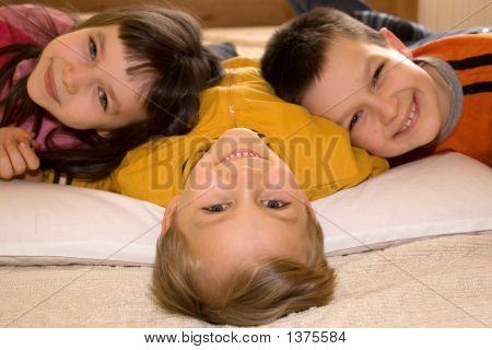 Portrait Of Three Happy Kids
