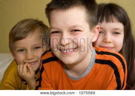 Three Children With Beaming Smiles