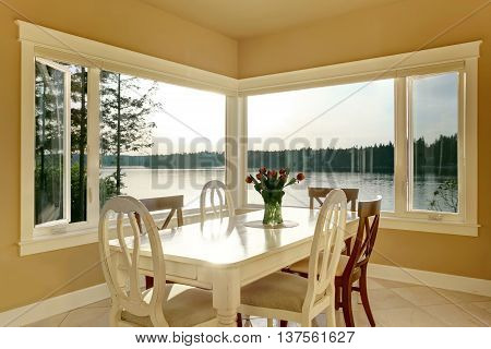 Dining Room Interior With White Table Set And Tile Floor.