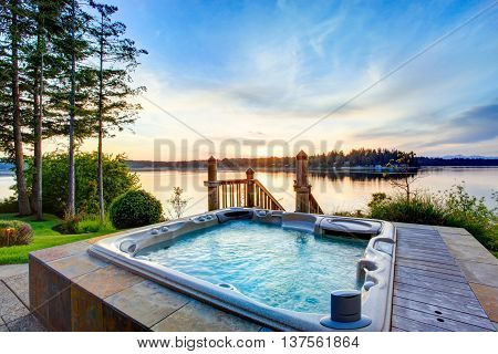Awesome Water View With Hot Tub In Summer Evening.