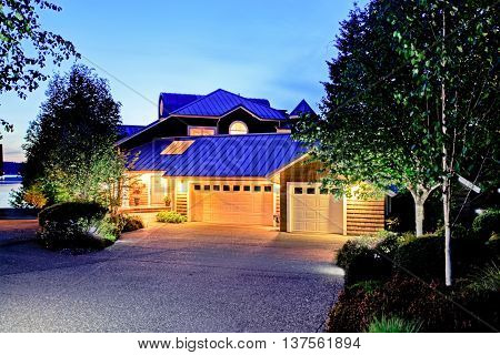 Lovely Curb Appeal Of Large Luxury House With Blue Roof.